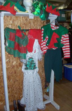 Elf hats (on the shelf), short and long aprons and an elf costume Office Christmas Party, Elf Costume, An Elf, Elf Hat, Christmas Costumes, Aprons, Elf On The Shelf, Shelves, Holiday Decor