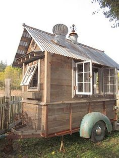 An old trailer provides the base for a movable shed on wheels made of reclaimed materials by Bob Bowling of Whidbey Island, Washington.