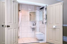 Obviously those doors are hideously ugly (and so is the tile). My only concern: How do you keep the toilet paper dry? No, really.