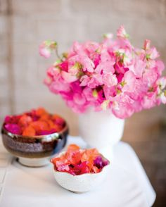 """Vases of sweetpeas and bowls of bougainvillea provide vibrant bursts of color. """"Our palette was inspired by my bachelorette weekend in Mexico,"""" says Heather. """"I loved the Bougainvillea I saw there."""""""