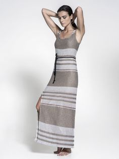 Maxi dress in knitted like fabric.<br /> COMPOSITION: 49% CO – 35% PC – 7% AF – 2% PL<br />