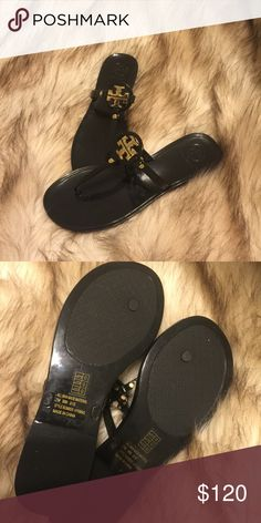 Tory burch jelly thong sandals, gold T Worn once  . Size 7 black jelly sandals . Shoes Sandals