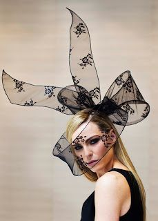 The couture upside bow hats on the bridesmaids had a particularly dark, and yet, whimsical style.