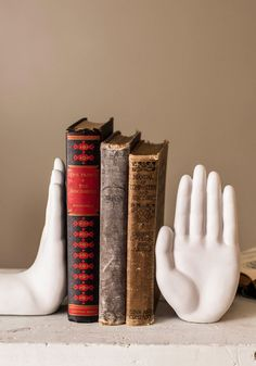 Gimme Five Bookends. Celebrate your collection of classic literature by displaying them between these handy, white, ceramic bookends! #white #modcloth