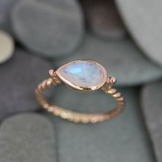 Size 6  Ready To Ship, Rainbow Moonstone and 14k Rose Gold Sideswept Ring. $678.00, via Etsy.    I would love this as an engagement ring!