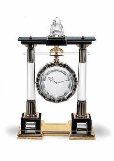 Cartier Portique Mystery Clock. Sinto Gate. Rock Crystal, Gold, Enamel, Platinum and Coral, circa 1923.
