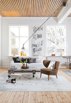 Love the natural wood ceiling which mirrors the floor & how cool is that lamp? - karin foberg