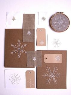 Snowflakes in paper, embroidered (on paper maybe, for cards), origami, and tatted. She has links for all the directions.