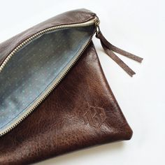 the marshall : zippered leather foldover by oatmeallacedesign. Love her products - my bridesmaids and I all have clutches made by her.