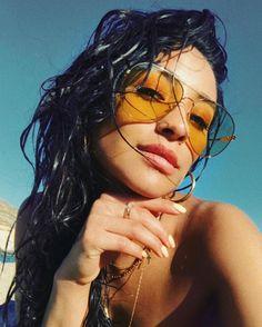 Shay Mitchell wearing yellow sunglasses