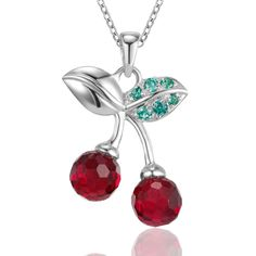 Feeling playful? Take your look from oridinary to original in seconds with this fruit-inspired jewelry. A duo of round cherries are created in deep, red gemstone simulants. A gleaming backdrop of sterling silver 'stems'and 'leaves' continue the fun theme that plays along your neckline. If your look needs a dose of girlish amusement, this pendant is perfect.
