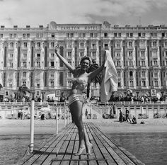 1956: Polish actress Bella Darvi poses in front of the Carlton Hotel during the Cannes Film Festival