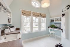 Love the idea of combining an office space/mudroom/laundry area. House of Turquoise: 2015 Coastal Virginia Magazine Idea House