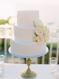 Classic white wedding cake | Photography: Clary Pfeiffer - www.claryphoto.com  View entire slideshow: Runway to Real Wedding: Classic on http://www.stylemepretty.com/collection/235/