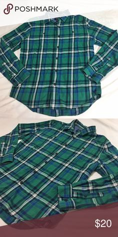 American Eagle Green Plaid Green plaid. Two pockets on the front with button detailing . Very soft . Used approximately twice. American Eagle Outfitters Shirts Casual Button Down Shirts