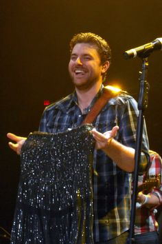 "Someone threw a ""little black dress"" to Chris Young on stage Chris Young Concert, Chris Young Songs, Country Music Artists, Country Singers, Alan Young, Sam Smith, Blake Shelton, Celebrity Travel, Wedding Tattoos"