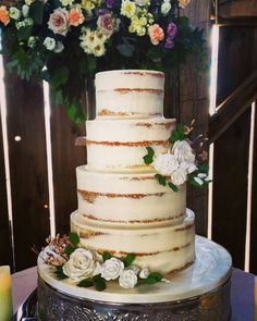 2017 Wedding Cake Trends - we love this partial naked cake by Patricia's Cake Creations in Toronto! We love this rustic-chic wedding cake! Whim Event Planning and Design, Toronto Wedding Planner and Day Of Coordinator.