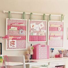 Storage made from frames, fabric and a curtain rod.  this could be a way of getting a big notice board up in a rental house.