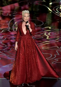 """In a ruby red gown, Pink takes us """"Over The Rainbow"""" during a performance in tribute of The Wizard Of Oz on the 86th Academy Awards on March 2 in Hollywood, Calif."""