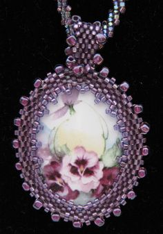 Purple Pansy Beaded Cabochon and Beaded Necklace. $65.00, via Etsy.  Bail idea