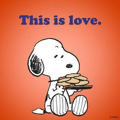 This is love! Snoopy loves his cookies...