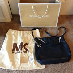 """Authentic Michael Kors Lily navy leather tote Authentic Michael Kors Lily Navy leather tote with sliver hardware.  Good condition, clean interior. No rips or stains! Includes original dustbag,  tags and MK shopper. Size is approx 15"""" x 16"""" Michael Kors Bags Totes"""