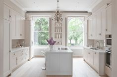 Lovely All White Kitchen with Large Windows