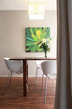 Dining Room, gray walls, white chairs, wood floor