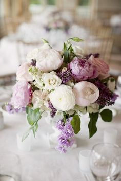 Soft colors - stunning!! I'm not so specific about the kinds of flowers or where this would be, but I love this look. So beautiful! Combinations of blush roses, purple, greens and creams!