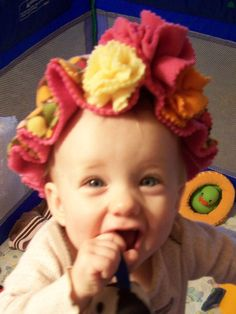 Handcrafted Ruffles and Flowers Infant Fleece Hat, multicolor on Etsy.com