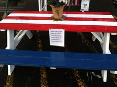 I love this painted picnic table at Lowe's! #patriotic #July4th #RedWhiteandBlue