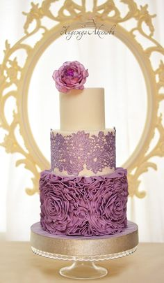 wedding cake with ruffles , lace and fondant flowers