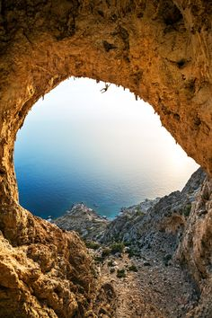Greetings from Telendos, Greece! The vaulted arc of this tiny island's Crystal Cave frames the Aegean and lures climbers to its dizzying apogee. Alpine Climbing, Ice Climbing, Places To Travel, Places To See, Outside Magazine, Escalade, Climbers, Greece Travel, Greek Islands
