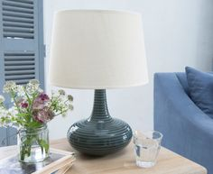 The lovely Low Ball lamp has a gorgeous handmade ceramic base which has a high-gloss glaze. It also comes with a lovely linen lamp shade.