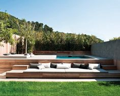 great swimming pool area: elevated deck and lots of lounging space