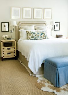 Giles says she uses a neutral backdrop in most of her interiors, and her own master bedroom is no different. Headboard, dust skirt and drapery fabrics, Rogers