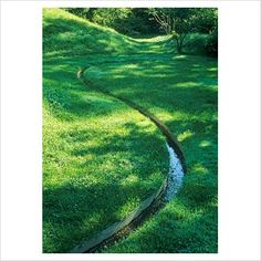 Land sculpting - Winding rill through grass in undulating garden with dips and mounds covered - The Healing Garden, Boston