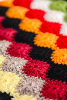 Crochet Blanket Pattern - the stitch pattern, it goes by many names, in certain circles it's known as the Harlequin stitch, the Star Shell, the Wheel stitch and also the Catherine Wheel. Have fun, this would make a great stash buster