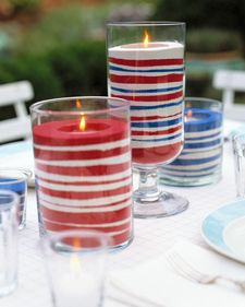 Red, white and blue colored sand with candles