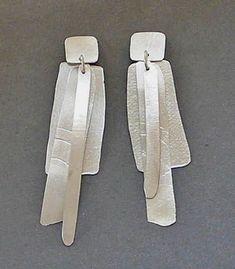 "Kathleen Faulkner: Wind Letter Earrings, Sterling silver earrings. Approx 3"" long."