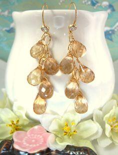Sun kissed mystic quartz tear drop gold hoop dangle earrings. $88.00, via Etsy.