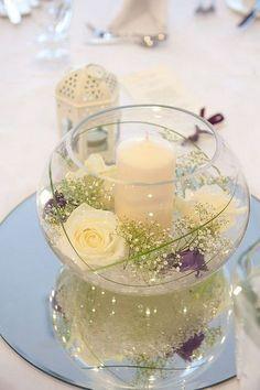 fish bowl 4 white flower wedding centerpiece / http://www.himisspuff.com/simple-elegant-all-white-wedding-color-ideas/3/ #heartcandleswedding #weddings #weddingflowers