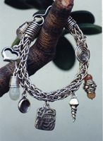 Hand woven bracelet with charms