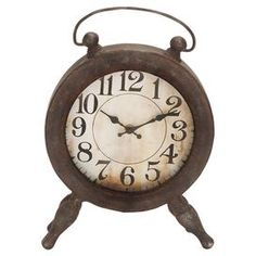 "Round table clock with a worn, rust finish.   Product: Table clockConstruction Material: Metal and glassColor: RustAccommodates: AAA Batteries - not includedDimensions: 13"" H x 10"" W x 3"" DCleaning and Care: For indoor use only"