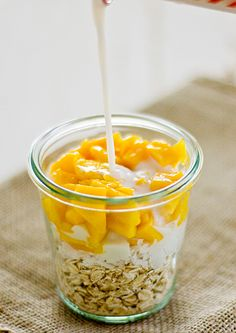 Coconut mango overnight oatmeal!  Ingredients1/2 c. rolled oats  1/2 c. unsweetened almond milk  1/2 c. mango, diced  1 tbsp. shredded coconut  1 1/2 tbsp. agave nectarInstructionsStir together all ingredients in a resealable jar or bowl. Cover and refrigerate overnight. Stir before serving and add additional milk (for a thinner consistency) and agave nectar if desired.