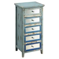 Weathered chest with mirrored drawer fronts.Product: ChestConstruction Material: Fir wood, MDF and mirrored glass  Color:  Antique blue  Features: Will enhance any spaceEye-catching designDimensions: 38.75 H x 19.25 W x 17.25 D