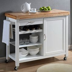 Update your kitchen with this functional, stylish Denver white kitchen island. This island with a butcher block chop, multiple cabinets, and wheeled legs with locking capabilities to keep in place while in use.