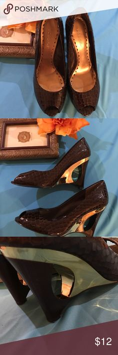 """⭐️BCBGirls Ladies 8 1/2B Shoes⭐️Blowout Price⭐️ The Sophisticated BCBGirls shoes are patent brown textured with gold trim on heels, a peep toe & 3 1/2"""" heels, they have some slight wear on bottom of sole and a little on inside, outer portion visible to eye could be mistaken for new...Bargain Price so please no offers!! Hope someone will enjoy these beauties!!!⭐️⭐️⭐️ BCBGirls Shoes Heels"""
