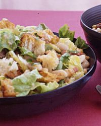 """White Beans with Escarole Recipe on Food & Wine """"I cribbed this salad from my grandmother Nonna,"""" Maria Helm Sinskey says. """"She'd toss leftover beans with greens and lemon juice."""" This version has toasted croutons; the lemon juice is mixed into a refreshing dressing."""