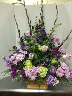 Purple floral tribute basket